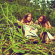 Two girls lying on the grass — Stock Photo
