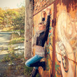 Girl on the graffiti background — Stock Photo
