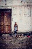 Girl in ruins — Stock Photo