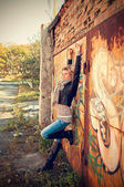 Girl on the graffiti background — Stock Photo