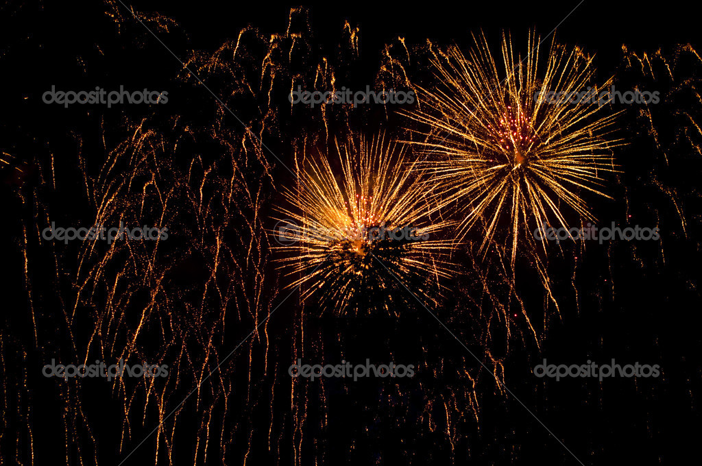 Fireworks in colorful shades of yellow and orange  Stock Photo #13715299