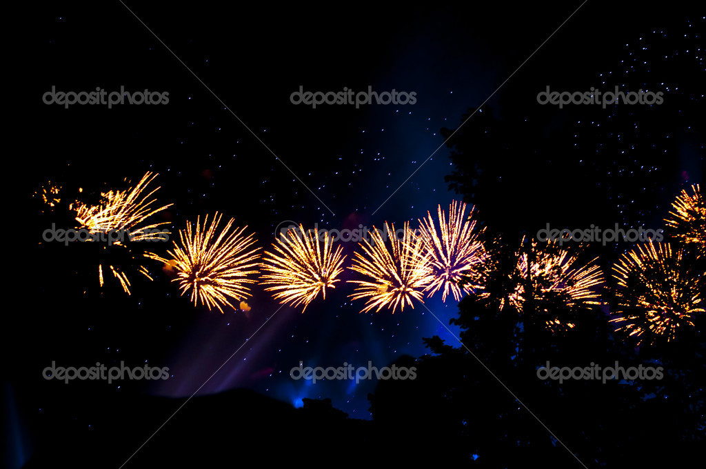 Fireworks in colorful shades of yellow and blue  Stock Photo #13715325