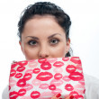 Stock Photo: Young woman with cosmetics bag