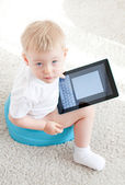 Little boy on the chamder with tablet pc — Stock Photo