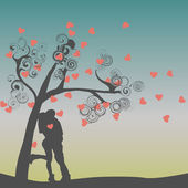 Silhouette of kissing couple — Stock Vector
