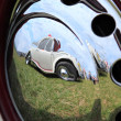 Stock Photo: Reflection in hubcap