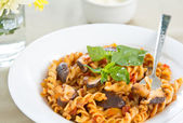 Fusilli with mushroom in tomato sauce — Stock Photo