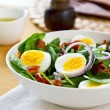 Bacon with egg and spinach salad — Stock Photo #40938409