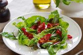 Sun-dried tomato with arugula salad — Stock Photo