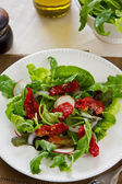 Sun-dried tomato with arugula salad — Stock Photo