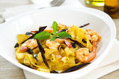 Tagliatelle with prawn and chili — Stock Photo