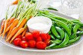 Fresh vegetables with dipping sauce — Stock Photo