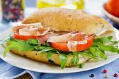 Prosciutto on Olive Ciabatta sandwich — Stock Photo