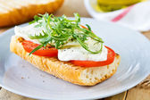 Mozzarella with rocket sandwich — Stock Photo