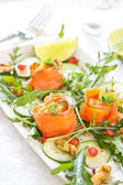 Smoked salmon with pomegranate and walnut salad — Stock Photo