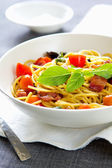 Spaghetti with bacon and dried chilli — Stock Photo