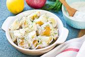 Potato with sour cream dressing salad — Stock Photo