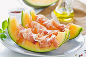 Cantaloupe with Prosciutto Antipasti — Stock Photo