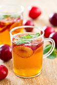 Plum juice with soda — Stock Photo