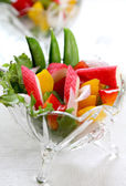 Crab stick with pepper and lettuce salad — Stock Photo