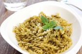 Pasta with pesto sauce — Stock Photo