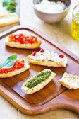 Crostini with Pesto, Cheese,and Tomato — Stock Photo