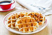 Waffle by Caramel sauce and coffee — Stock Photo