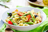 Gnocchi with Asparagus salad in Pesto dressing — Stock Photo