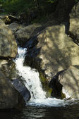Creek waterfall in rocks — Stock Photo