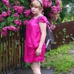 Girl with a rosebush, rosebush, blonde with flowers — Stock Photo #12523375