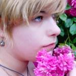 Girl with a rosebush, rosebush, blonde with flowers — Stock Photo #12523376