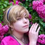 Girl with a rosebush, rosebush, blonde with flowers — Stock Photo #12523377