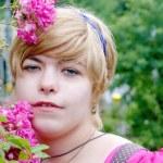Girl with a rosebush, rosebush, blonde with flowers — Stock Photo #12523382