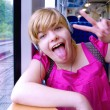Blonde in train — Stock fotografie #12523394