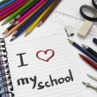 "Notebook ""i love my school"" and school supplies — ストック写真"