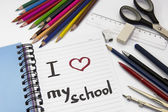 "Notebook ""i love my school"" and school supplies — Стоковое фото"