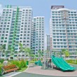 Playground within high-rise residential estate — Stock Photo #12680240