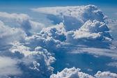 White cloud, blue sky, height — Stock Photo