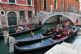 Venetian gondoliers resting in their gondolas — Stock Photo