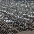 Rows of metal chairs — Stok fotoğraf