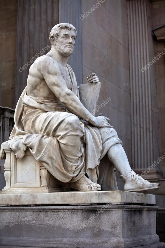Statue of a history scholar in the ancient Greek style, situated in front of the building of Austrian Parliament.    #13524580