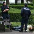 Stock Photo: Viennpolicemen inspecting mlaying on ground