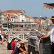Venice gondolier waiting for tourists to take a gondola ride - Stock Photo