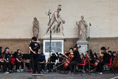 Chinese classical orchestra performing at the Loggia della Signo — Stock Photo