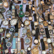 Stock Photo: Clocks on flee market