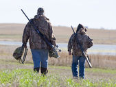 Father and son hunting — Stock Photo