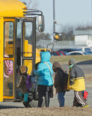 Children at the bus stop — Stock Photo