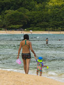 Mother and Child on the beach — Stock Photo