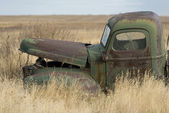 An old rusty farm truck — Stock Photo