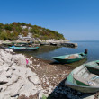 Boats on the stone beach — Stock Photo #13180267